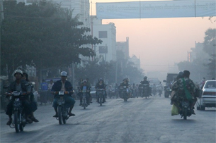 At U.S. $600, motorbikes from China are popular in Burma, and are a big part of Mandalay's air-quality woes.