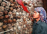 Dec. 9, 1998: Cambodian Sam Vishna, 28, looks at a mixture of brown and white skulls that make up a map of Cambodia at Tuol Sleng (S-21 prison) Museum in Phnom Penh. Photo: AFP/Rob Elliott