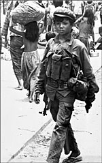 April 17, 1975 A young Khmer Rouge fighter patrolling in the streets of Phnom Penh. Photo: AFP/Claude Juvenal