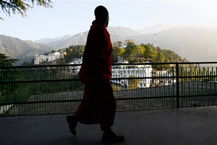 DHARAMSALA, India: A Tibetan monk in exile walks in the compound of the Tsuglakhang Temple, Nov. 16, 2008.