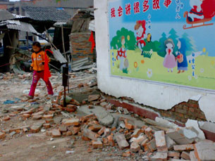 An elementary school in Anxian, Sichuan, where debris lies scattered around a colorfully painted wall, photographed on May 22, 2008.