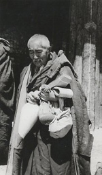 At Sera monastery in 1988, a monk carries bags of tsampa, or roasted barley, a staple for Tibetans.Photo: RFA/Dan Southerland