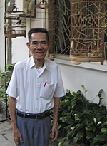 Pham Xuan An with his birdcages in Ho Chi Minh City, 2005Photo: RFA/Dan Southerland