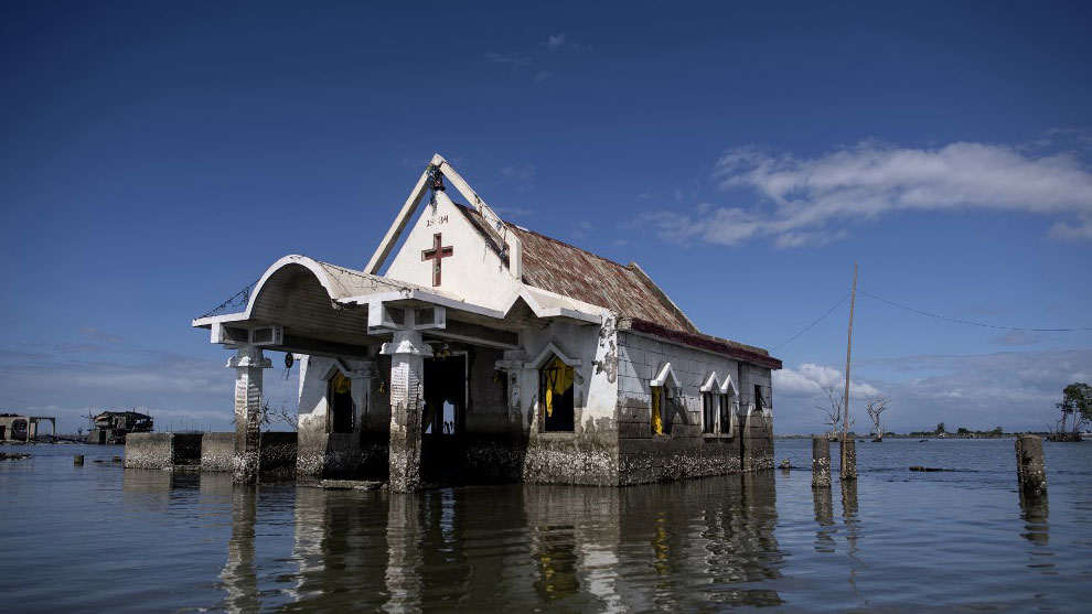 A chapel and intruding waters in Bulacan, a region in the Philippines that has sunk 1.5-2.4 inches a year since 2003.