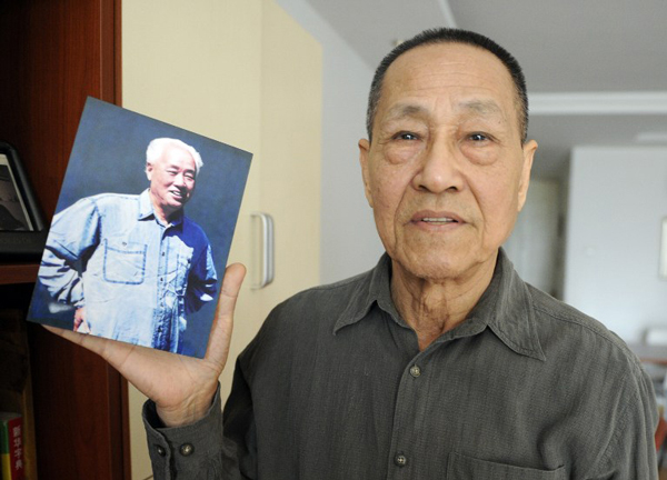 Bao Tong shows a photo of his former boss, Zhao Ziyang, a leading reformer and former secretary-general of the Chinese Communist Party, at his home in Beijing, Feb. 22, 2011.