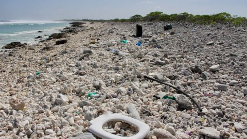Plastic trash is seen strewn across a beach at Wake Island in the Pacific Ocean, Feb. 2, 2018.