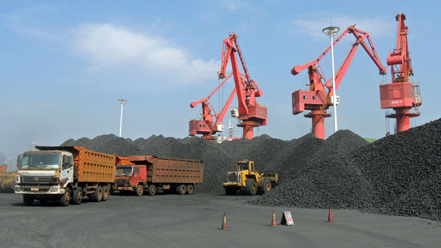 Cranes transfer coal at a port in Lianyungang, eastern China's Jiangsu province, Dec. 6, 2018.