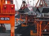 Cranes transfer coal at a port in Lianyungang, eastern China's Jiangsu province, Dec. 6, 2018.
