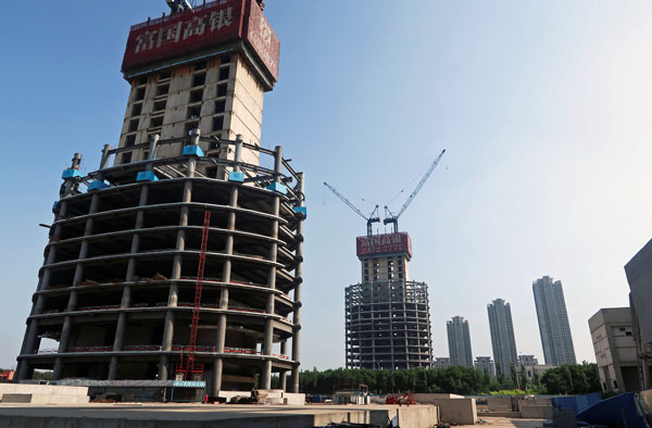A construction site surrounding the Goldin Finance 117 skyscraper lies dormant in the high-tech zone of the coastal metropolis Tianjin in northern China, May 25, 2018.