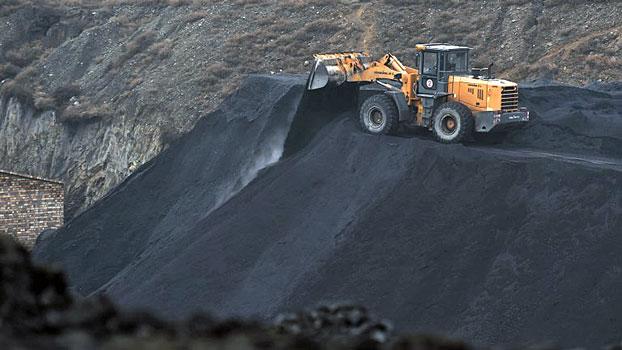 A front-end loader drops a load of coal near a coal mine at Datong, northern China's Shanxi province, Nov. 20, 2015.