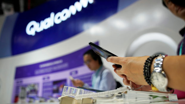 A Qualcomm sign is seen during the China International Import Expo at the National Exhibition and Convention Center in Shanghai, Nov. 7, 2018.