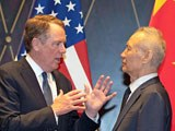 US Trade Representative Robert Lighthizer (C) gestures as he chats with Chinese Vice Premier Liu He (R), with Treasury Secretary Steven Mnuchin (L) looking on at the Xijiao Conference Center in Shanghai, China, July 31, 2019.