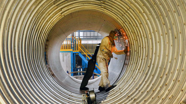 A worker welds a liquefied natural gas tank at a factory in Nantong, eastern China's Jiangsu province, March 14, 2019.