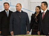 Russia's gas giant Gazprom CEO Alexei Miller (L), Russian President Vladimir Putin (2nd L), and Chinese Vice Premier Zhang Gaoli (R) attend a ceremony marking the welding of the first link of the Power of Siberia main gas pipeline near the village of Us Khatyn outside the remote eastern city of Yakutsk, Russia, Sept. 1, 2014.