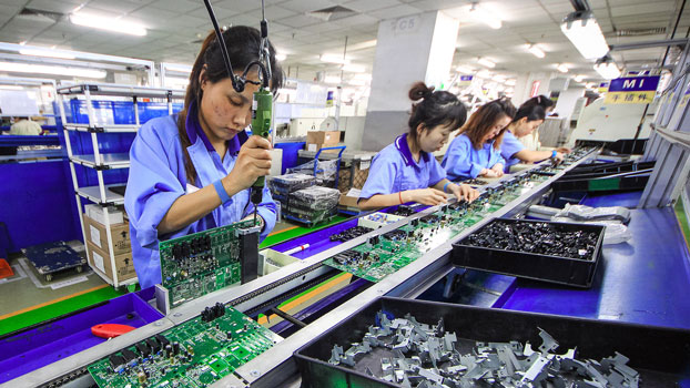 Women work on the production line manufacturing electronic keyboards at a factory of the Tianjin Yamaha Electronic Musical Instruments Co. in Tianjin, China, Dec. 4, 2018.