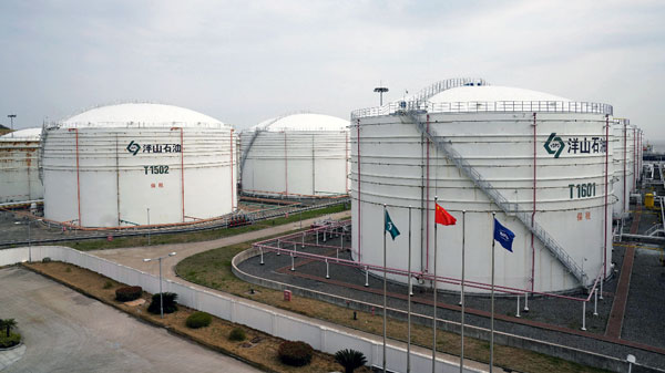Oil tanks are seen at an oil warehouse at Yangshan port in Shanghai, China, March 14, 2018.