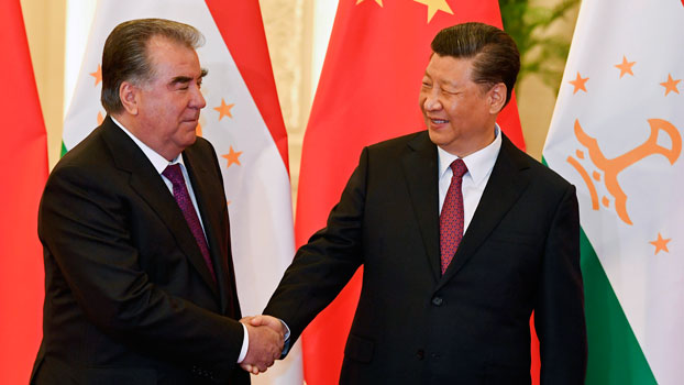 China's President Xi Jinping (R) shakes hands with Tajikistan's President Emomali Rahmon (L) before their meeting at the Great Hall of the People in Beijing, Apr. 28, 2019.