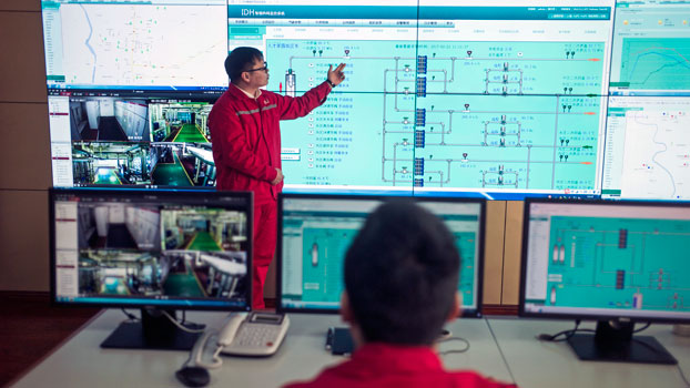 A worker from Chinese oil giant Sinopec shows control panels to journalists in Zangangzhen, northern China's Heibei province, Feb. 23, 2017.