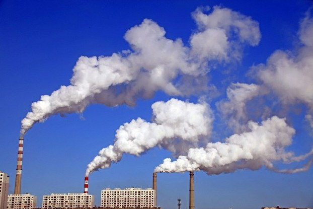 Smoke is discharged from chimneys at a coal-fired power plant in Jilin city, Jan. 8, 2014.