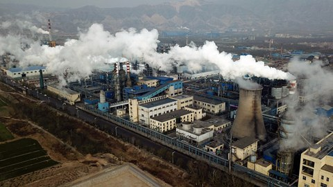 Smoke and steam rise from a coal processing plant in Hejin, central China's Shanxi province, Nov. 28, 2019.