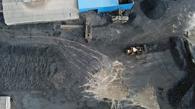 A coal storage facility is seen from above in Hejin, central China's Shanxi Province, Nov. 28, 2019.
