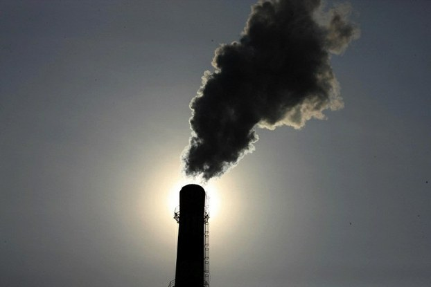 Smoke rises from a chimney at a coal chemical factory in Huaibei, east China's Anhui province, Aug. 14, 2013.