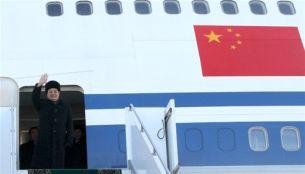 Chinese President Hu Jintao waves upon his arrival in Kazakhstan, Dec. 12, 2009.
