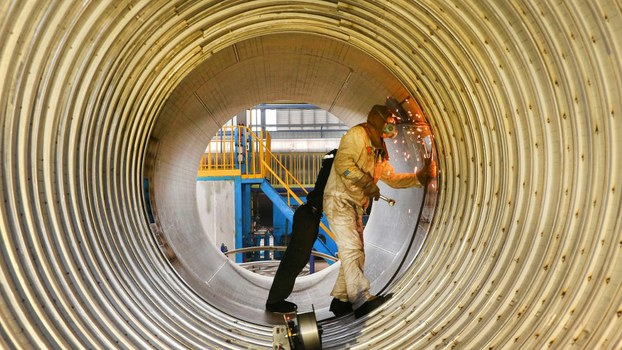 A worker welds a liquefied natural gas (LNG) tank at a factory in Nantong in China's eastern Jiangsu province, March 14, 2019.