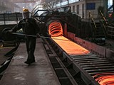 An employee sorts red-hot steel at a steel plant in Lianyungang, in China's eastern Jiangsu province, Sept. 23, 2019.