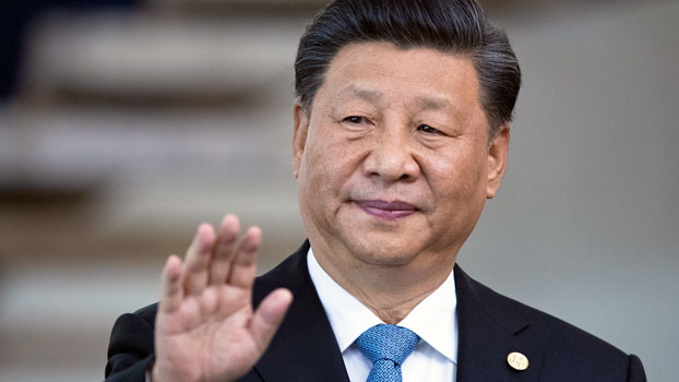 China's President Xi Jinping greets the media prior to a meeting of leaders of the BRICS emerging economies in Brasilia, Brazil, Nov. 14, 2019.