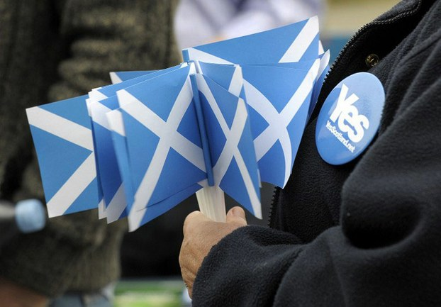 A pro-independence supporter holds campaign material during a rally ahead of the referendum on Scotland's independence in Glasgow, Scotland, Sept. 12, 2014.