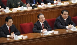 Li Changchun (r) sits by President Hu Jintao (l) and Premier Wen Jiabao (c) at the closing session of the National People's Congress in Beijing, March 14, 2010.