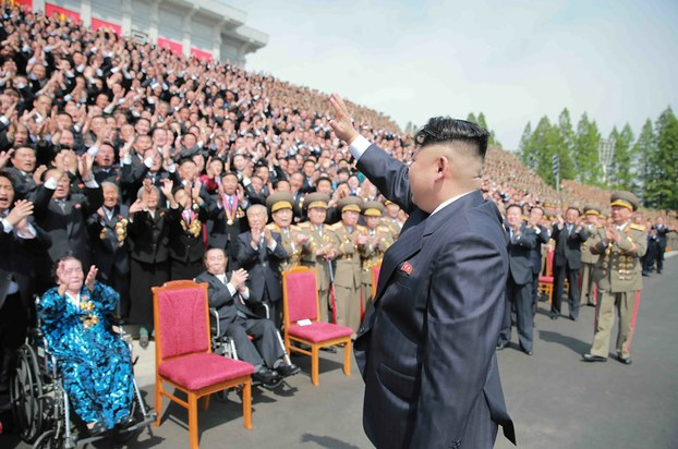 North Korean leader Kim Jong Un attending a photo session with the participants in the Seventh Congress of the Workers' Party of Korea, in undated picture released from North Korea's official Korean Central News Agency (KCNA), May 13, 2016.