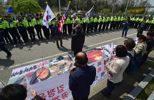 South Korean activists display banners lampooning North Korean leader Kim Jong Un as police block the launch of anti-North Korea balloons across the border on the birthday of the North's founding leader Kim Il Sung, April 15, 2016.
