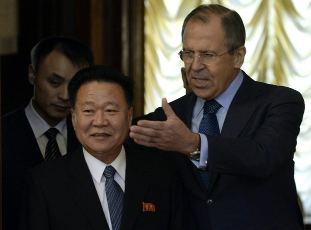 Russian Foreign Minister Sergei Lavrov (R) welcomes North Korean leader Kim Jong Un's special envoy Choe Ryong Hae during their meeting in Moscow, Nov. 20, 2014.