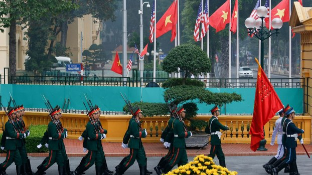 Vietnamese honor guard march before a welcoming ceremony for U.S. President Donald Trump at the Presidential Palace in Hanoi in Hanoi, Nov. 12, 2017.
