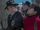 War author and correspondent Joseph Galloway (R) walks with his wife Dr. Gracie Liem Szuan Tzu