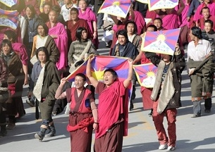 Monks carrying the Tibetan flag lead protesters on March 14, 2008, in Sangchu (in Chinese, Xiahe), Gansu province. Protests against Chinese rule started in Lhasa and spread throughout Tibetan areas, triggering a crackdown.