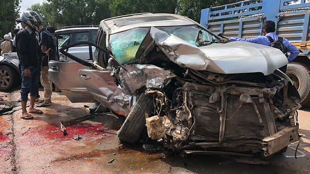 Cambodia's Prince Norodom Ranariddh's mangled car sits on the side of a road after a collision with another vehicle outside Sihanoukville, June 17, 2018.