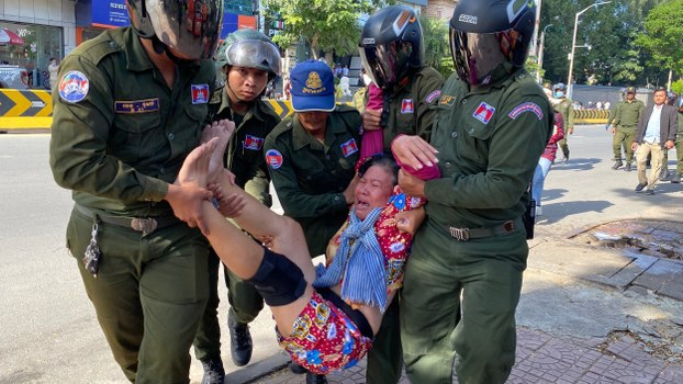 Sat Pha is taken away by authorities while protesting in front of the Chinese embassy in Phnom Penh, Oct. 23, 2020.