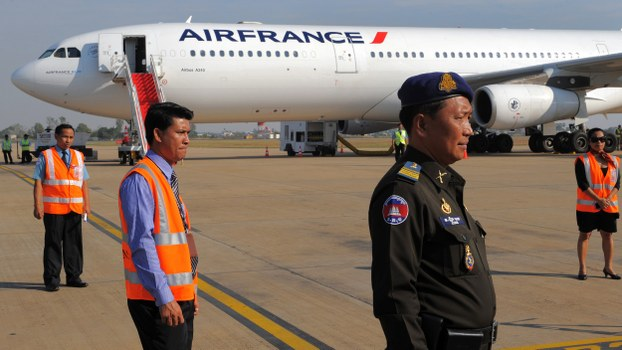 A Cambodian military policeman stands guard in front of an aircraft at Phnom Penh International Airport, in a file photo.
