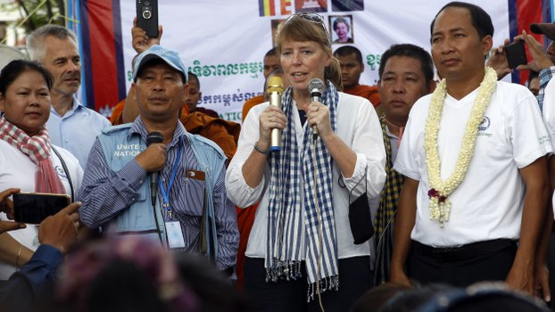 UN Special Rapporteur on Human Rights in Cambodia Rhona Smith (C) delivers a speech alongside Ath Thun (R), president of the Coalition of Cambodian Apparel Workers' Democratic Union, during a gathering to mark May Day in Phnom Penh, May 1, 2019.
