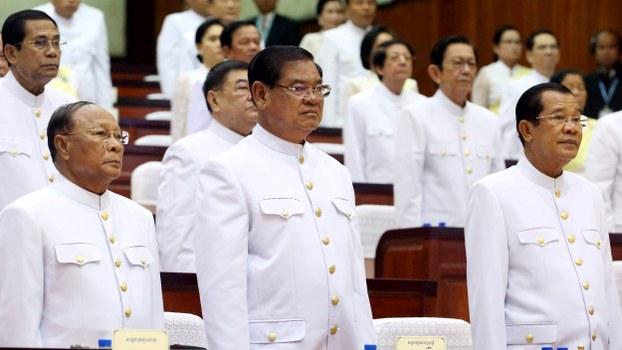 Cambodian Prime Minister Hun Sen (Front-R) attends the opening of parliament with party leaders Heng Samrin (Front-L) and Sar Kheng (Front-C) in Phnom Penh, Sept. 5, 2018.