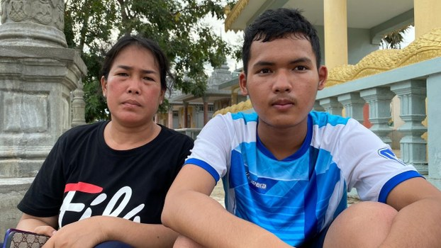 Prum Chantha (L) and her son sit at a Buddhist temple near Prey Sar Prison in Phnom Penh, Oct. 6, 2020.