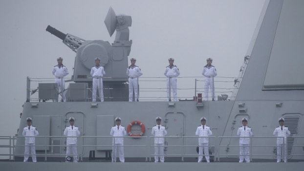 Sailors stand on the deck of a missile destroyer of the Chinese People's Liberation Army (PLA) Navy as it participates in a naval parade in the sea near Qingdao, in eastern China's Shandong province, April 23, 2019.