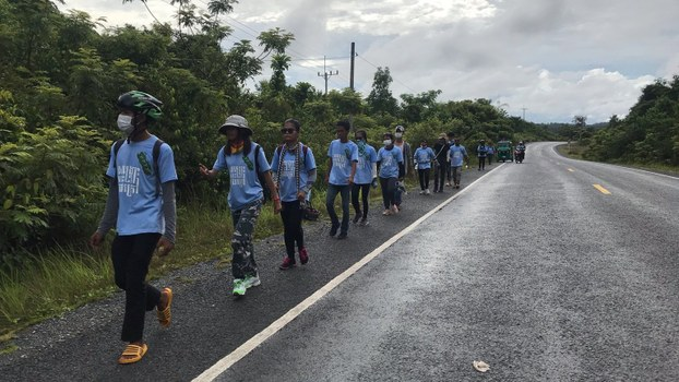 Mother Nature youth activists walk to Phnom Penh from Koh Kong township after their bicycles were confiscated by the authorities, June 4, 2020.