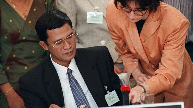 Cambodian Prime Minister Hun Sen signs a peace treaty to end 21 years of civil war in Cambodia, in Paris, in a file photo.