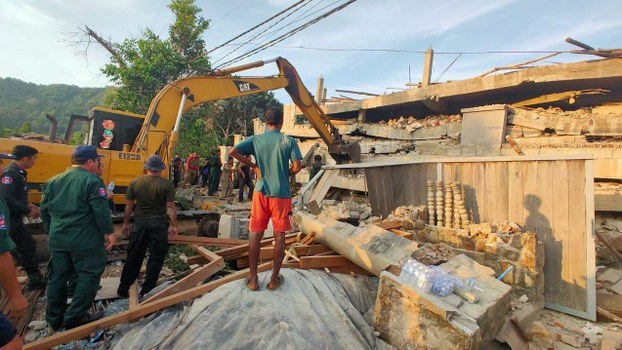 In a photo provided by the Kep Province Authority Police, heavy machinery removes debris after a building collapsed in Kep province, Cambodia, Friday, Jan. 3, 2020.