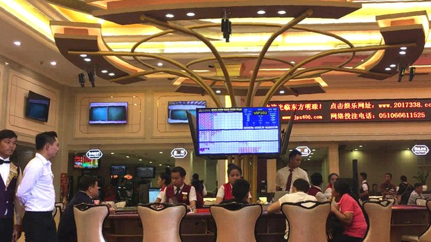 This still photo from a video grab taken on December 13, 2018 shows Chinese customers gambling inside a Chinese-run casino in Sihanoukville, the coastal capital of Preah Sihanouk province.