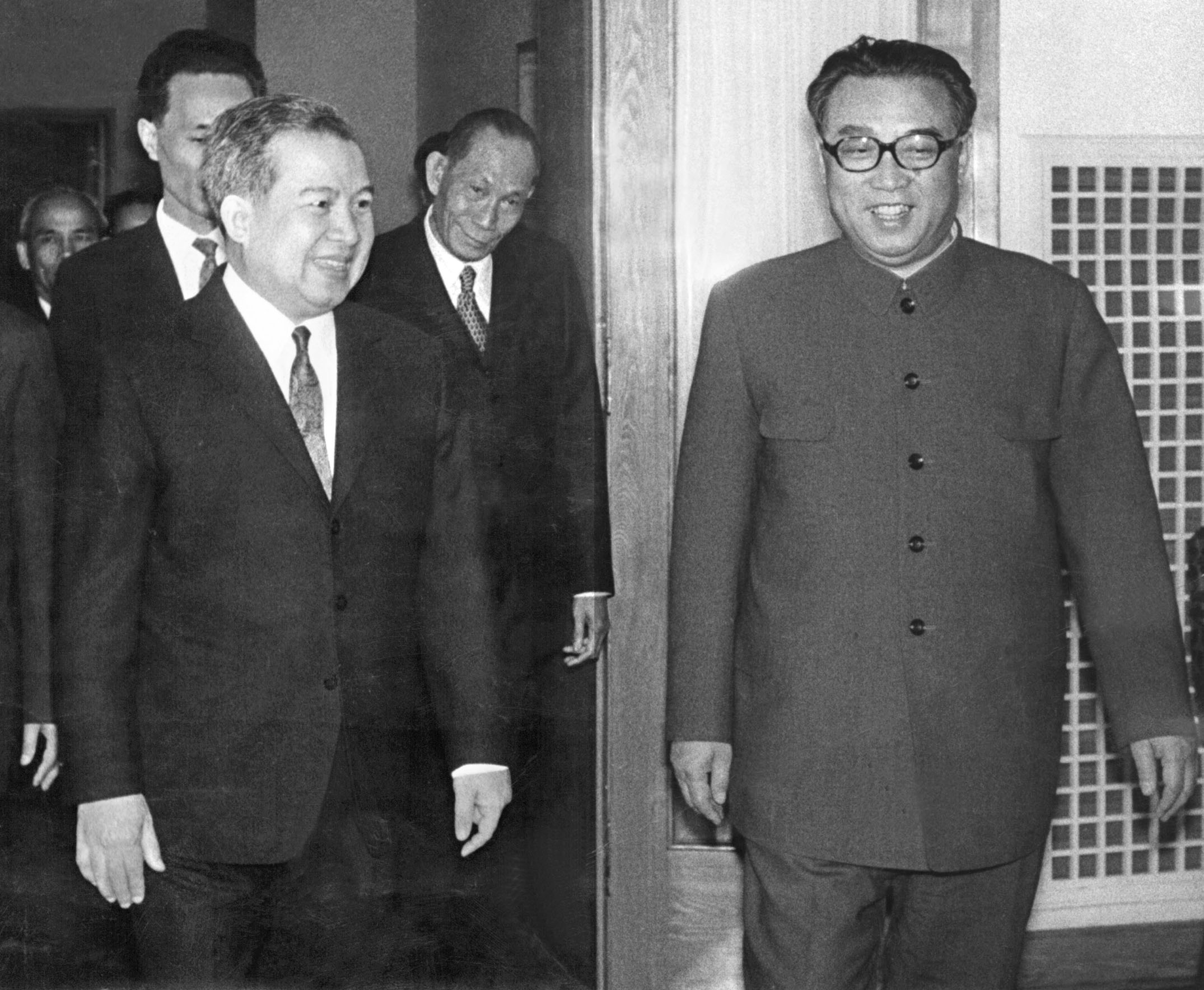 "Norodom Sihanouk, former King of Cambodia (l) is welcomed 22 April 1975 in Pyongyang by North Korean President and ""Great Leader"" Kim Il-Sung (r)."